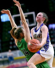 Allison L'Amoreaux (5) goes up to score past Seton's Lily Combs (14) as Maine-Endwell defeated Seton Catholic Central with a final score of 58-52 in the Section 4, Class A Girls Basketball Championship at the Broome County Veterans Memorial Arena in Binghamton. Sunday, March 8, 2020.