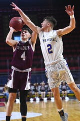 Johnson City's Dean VanFossen (4) shoots past Maine-Endwell's Mike Mancini (2) during Sunday's championship game. Johnson City defeated Maine-Endwell with a final score of 83-56 in the Section 4, Class A Boys Basketball Championship at the Broome County Veterans Memorial Arena in Binghamton. Sunday, March 8, 2020.