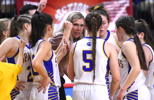 Maine-Endwell coach Brianna Thompson talks to team during a timeout during Sunday's game. Maine-Endwell defeated Seton Catholic Central with a final score of 58-52 in the Section 4, Class A Girls Basketball Championship at the Broome County Veterans Memorial Arena in Binghamton. Sunday, March 8, 2020.