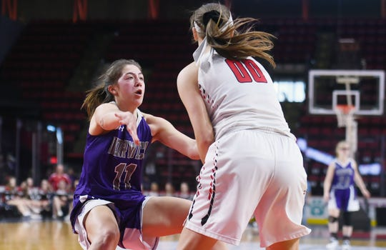 Abby Flynn of Norwich (11) tries to block Newark Valley's Mackenna Nechwedowich (00) during Sunday's game. Norwich defeated Newark Valley with a final score of 58 - 46 to capture the Section 4, Class B, Girls Basketball Championship at the Broome County Veterans Memorial Arena. Sunday, March 8, 2020.