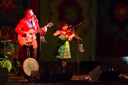 John Moen onstage with fiddler Alice Tilton.