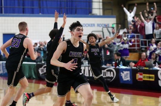 North Kitsap's Jonas La Tour sprints across the floor in celebration after Saturday's state-championship win.