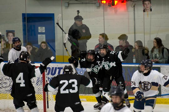 Stowe players react after Alex Tilgner's go-ahead goal against Essex during a Division I high school boys hockey semifinal game in Essex on Saturday, March 7, 2020.