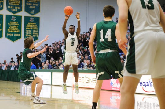 Rice's Mo Awayle (5) shoots the ball during the boys high school DI basketball championship game between the St. Johnsbury Hilltoppers and the Rice Green Knights at Patrick Gym on Sunday afternoon March 8, 2020 in Burlington, Vermont.