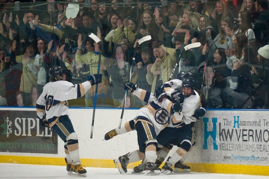 Essex players celebrate a goal by Ryan Clark during a Division I high school boys hockey semifinal game in Essex on Saturday, March 7, 2020.