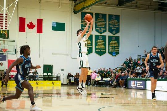 Vermont senior Everett Duncan shoots a 3-pointer vs. Maine during the America East men's basketball quarterfinals at Patrick Gym.