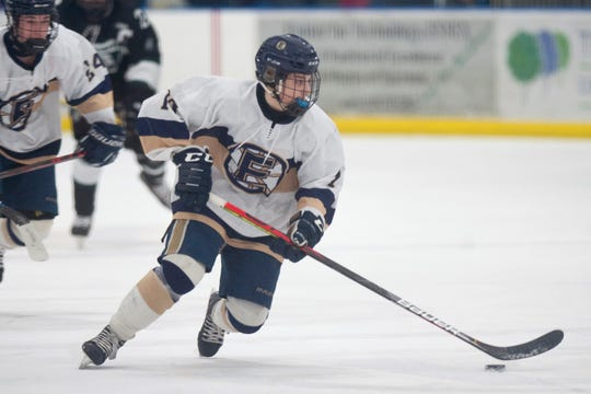 Essex's Justin Prim skates through the neutral zone during a Division I high school boys hockey semifinal game in Essex on Saturday, March 7, 2020.