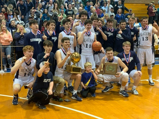 Fair Haven poses with the D-II boys basketball trophy.