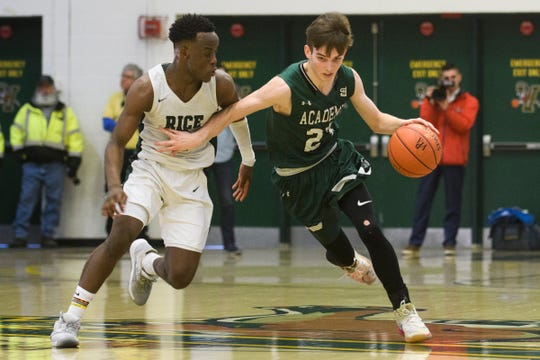 St. Johnsbury's Logan Wendell (23) dribbles the ball down the court past Rice's Michel Ndayishimiye (2) during the boys high school DI basketball championship game between the St. Johnsbury Hilltoppers and the Rice Green Knights at Patrick Gym on Sunday afternoon March 8, 2020 in Burlington, Vermont.