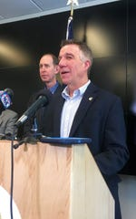 Vermont Gov. Phil Scott speaks at a news conference announcing the first case of coronavirus, or COVID-19, in Vermont. He was joined by Health Commissioner Dr. Mark Levine, left, and several other state officials at the announcement in Waterbury on Sunday, March 8, 2020.