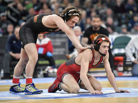 Robert Howard of Bergen Catholic, left, faces McKenzie Bell of Kingsway in the 126-pound final of the NJSIAA State Wrestling Championships at Boardwalk Hall in Atlantic City on Saturday, March 7, 2020.