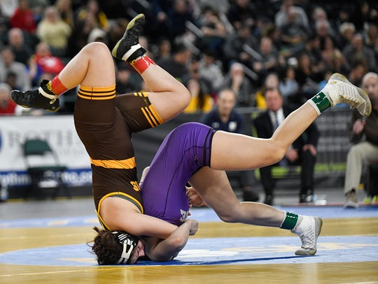 Emma Matera of Delran, left, defeats Gabby Miller of Monroe Township in the 135-pound final of the NJSIAA State Wrestling Championships at Boardwalk Hall in Atlantic City on Saturday, March 7, 2020.