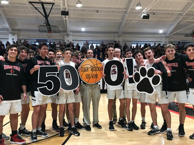 Haddonfield boys basketball coach Paul Wiedeman poses with his team after winning his 500th game on Saturday, a thrilling 35-33 triumph over Haddon Heights in the South Jersey Group 2 semifinals.