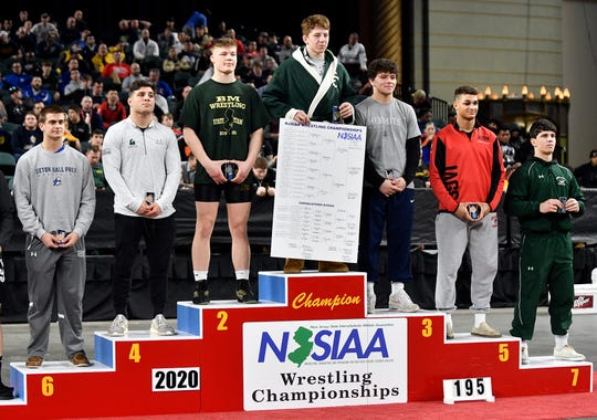 Martin Cosgrove of Camden Catholic stands atop the winner's podium in the 195-pound weight class of the NJSIAA State Wrestling Championships at Boardwalk Hall in Atlantic City on Saturday, March 7, 2020.
