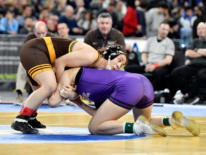 Delran's Emma Matera left, defeats Gabby Miller of Monroe Township in the 135-pound final of the NJSIAA State Wrestling Championships at Boardwalk Hall in Atlantic City last season. Matera begins her state title defense on Saturday in the South Region Tournament.