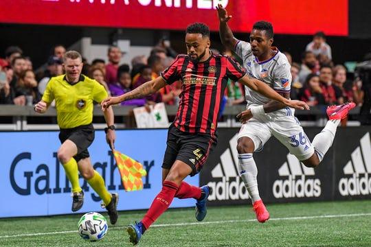 Mar 7, 2020; Atlanta, Georgia, USA;  Atlanta United defender Anton Walkes (4) and FC Cincinnati midfielder Joseph-Claude Gyau (36) chase the ball during the first half at Mercedes-Benz Stadium.