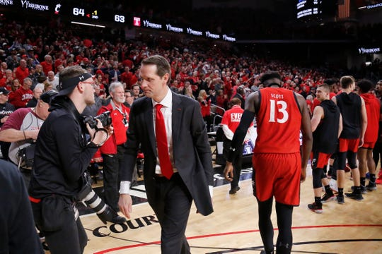 Cincinnati Bearcats head coach John Brannen heads for the locker room after the second half of the NCAA America Athletic Conference basketball game between the Cincinnati Bearcats and the Temple Owls at Fifth Third Arena in Cincinnati on Saturday, March 7, 2020. The Bearcats came back from a 31-17 halftime deficit to win 64-63 on senior night.