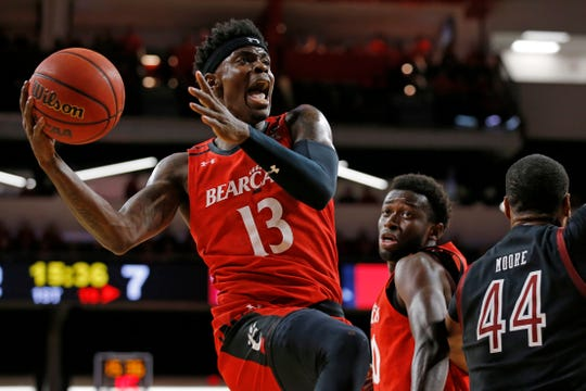 Cincinnati Bearcats forward Tre Scott (13) goes for a layup in the first half of the NCAA America Athletic Conference basketball game between the Cincinnati Bearcats and the Temple Owls at Fifth Third Arena in Cincinnati on Saturday, March 7, 2020. The Bearcats trailed 31-17 at halftime.
