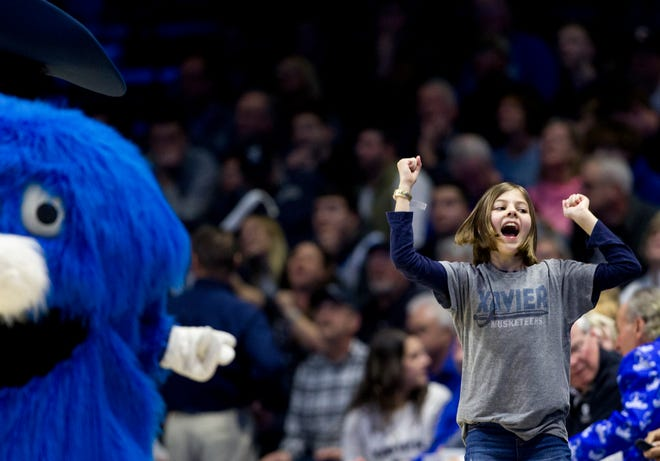 Xavier Musketeers fan dances in the second half of the NCAA men's basketball game on Saturday, March 7, 2020, in the Cintas Center at Xavier University.