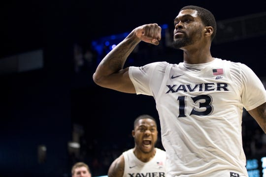 Xavier Musketeers forward Naji Marshall (13) celebrates after hitting a layup putting Xavier Musketeers up by two points with less than 10 second left in the second half of the NCAA men's basketball game on Saturday, March 7, 2020, in the Cintas Center at Xavier University.