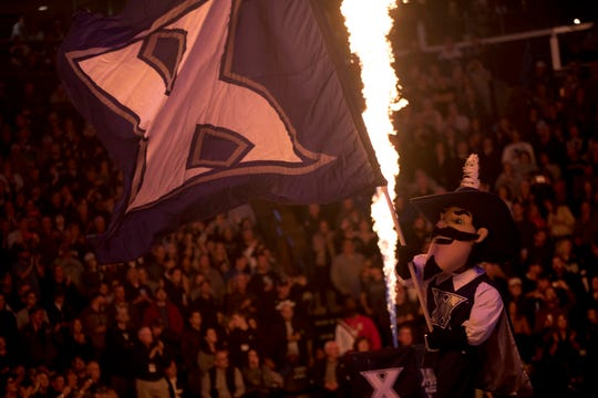 Xavier Musketeers mascot D'Artagnan the Musketeer waives a flag before the NCAA men's basketball game on Saturday, March 7, 2020, between the Xavier Musketeers and the Butler Bulldogs in the Cintas Center at Xavier University.