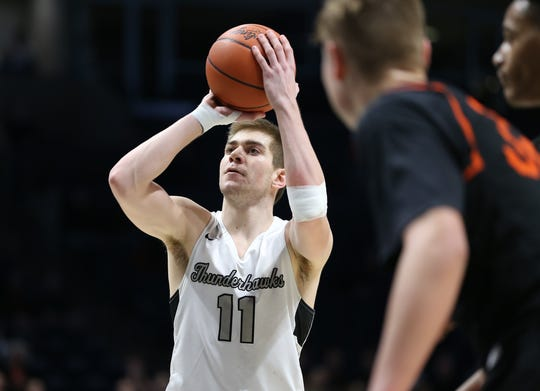 Lakota East's Alex Mangold  shoots a free throw at the end of their 33-32 win over Beavercreek, Sunday, March 8, 2020.