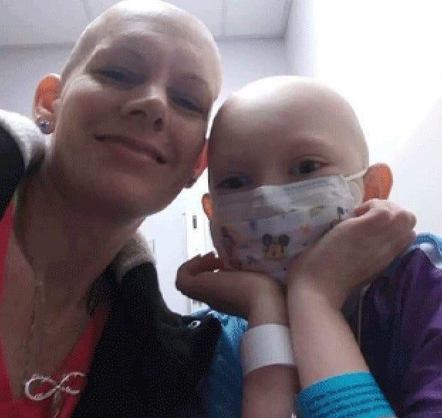 Naomi's mother, Melissa, shaved her head, too, as a show of support as the 8-year-old Butler County girl battles a rare form of stage 4 brain cancer.