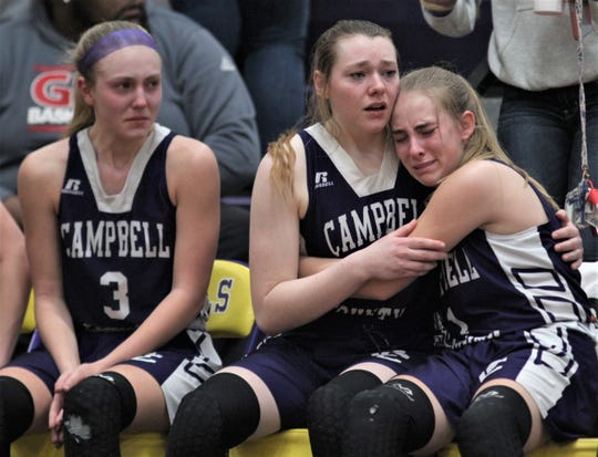 Campbell County players react to their season-ending loss in the 10th Region final, March 7 ,2020