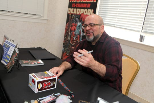 Fabian Nicieza, co-creator of Deadpool, signs autographs at the ClarksvilleCon in Clarksville, Tenn., on Saturday, March 7, 2020.