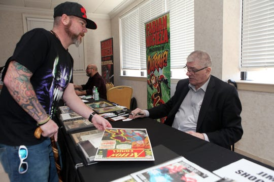 Jeremy Parker has memorabilia autographed by legendary writer Jim Shooter at the ClarksvilleCon on Saturday, March 7, 2020.