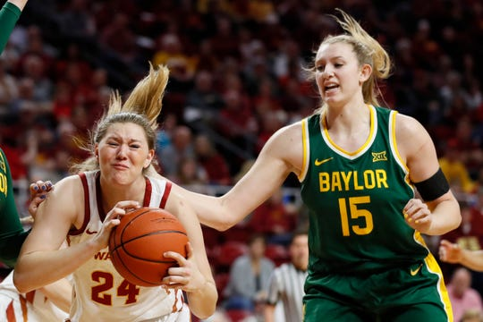 Iowa State guard Ashley Joens, left, grabs a rebound in front of Baylor forward Lauren Cox, right, during the first half of an NCAA college basketball game, Sunday, March 8, 2020, in Ames, Iowa.
