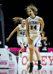 Newell-Fonda's Megan Morenz (34) reacts after hitting the game winning shot in the final seconds of their 1A state championship basketball game against Bishop Garrigan to win 65-63 at Wells Fargo Arena on Saturday, March 7, 2020, in Des Moines.