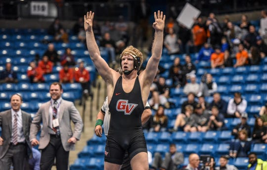 Grand View's Evan Hansen celebrates winning a fourth NAIA national title on Saturday night in Park City, Kansas. Hansen went 5-0 and won at 197 pounds, becoming the eighth four-time national champion in NAIA wrestling history. The Vikings also won their ninth-straight team crown.