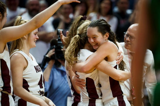 North Linn Grace Flanagan (22) is hugged as she comes off the court during their 2A state championship basketball game at Wells Fargo Arena on Saturday, March 7, 2020, in Des Moines. North Linn would go on to beat Osage 66-42 to win the 2A championship.