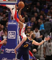 Detroit Pistons forward Christian Wood scores against Utah Jazz guard Joe Ingles during the first half Saturday, March 7, 2020 at Little Caesars Arena.