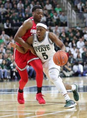Michigan State guard Cassius Winston drives against Ohio State forward Andre Wesson during the first half Sunday, March 8, 2020 at the Breslin Center.