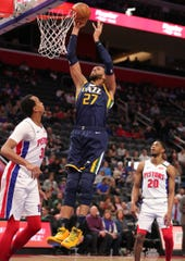 Utah Jazz center Rudy Gobert scores over Detroit Pistons forward John Henson during the first half Saturday, March 7, 2020 at Little Caesars Arena.