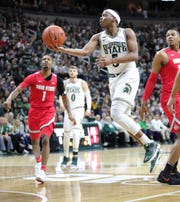 Michigan State's Cassius Winston scores against Ohio State during the first half Sunday, March 8, 2020 at the Breslin Center.