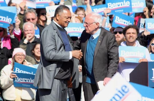 The Rev. Jesse Jackson greets U. S. Senator Bernie Sanders during a rally stop on Sunday, March 8, in Grand Rapids.