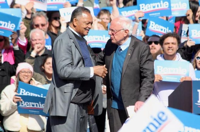 The Rev. Jesse Jackson greets U. S. Senator Bernie Sanders during a rally stop on Sunday, March 8, in Grand Rapids.