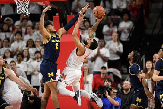 Maryland guard Eric Ayala goes to the basket vs. Michigan forward Isaiah Livers during the first half Sunday, March 8, 2020, in College Park, Md.