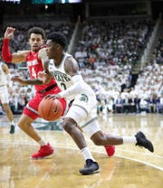 Michigan State guard Rocket Watts drives against Ohio State guard Duane Washington Jr. during the first half Sunday, March 8, 2020 at the Breslin Center.