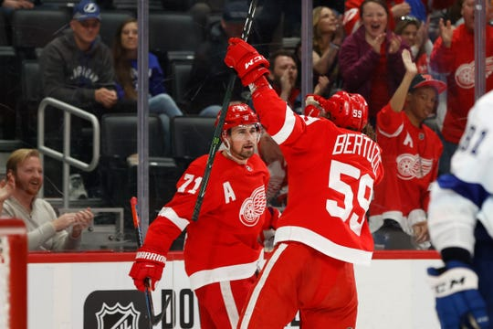 Detroit Red Wings center Dylan Larkin celebrates with left wing Tyler Bertuzzi after scoring in the second period against the Tampa Bay Lightning at Little Caesars Arena, Sunday, March 8, 2020, in Detroit.