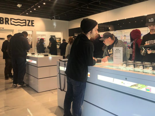 Employees at Breeze, known as bud tenders, work with customers at the shop's Hazel Park location on Sunday..
