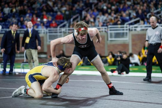 Lowell's Austin Boone tries to escape from Gaylord's Chayse LaJoie during MHSAA Division 2 145 pounds wrestling individual finals at Ford Field in Detroit, Saturday, March 7, 2020.