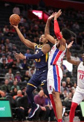 Detroit Pistons forward Christian Wood defends Utah Jazz guard Donovan Mitchell during the first half Saturday, March 7, 2020 at Little Caesars Arena.