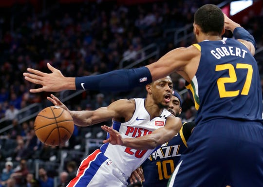 Detroit Pistons guard Brandon Knight plays against Utah Jazz guard Mike Conley (10) and center Rudy Gobert (27) on March 7 at Little Caesars Arena. Gobert was later confirmed to have the coronavirus.