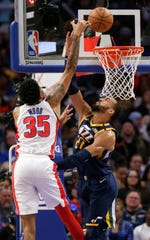 Detroit Pistons forward Christian Wood (35) takes a shot over Utah Jazz center Rudy Gobert (27) during the second half.