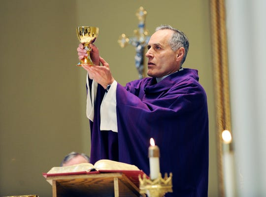 The Rev. Jim Bilot said the bread of communion is the body of Christ, and as the body contains the blood, it's all that's necessary for communion.
