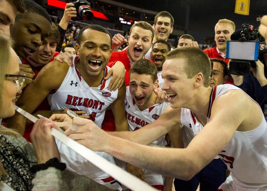 Belmont's Adam Kunkel (5) puts the Belmont Bruins sticker on the big-ticket after beating the Murray State Racers in the Ohio Valley Conference Championship game at Ford Center Saturday evening, March 7, 2020.